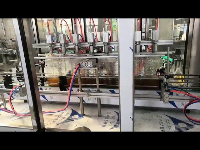 آلة تعبئة زيت المحرك الأوتوماتيكية